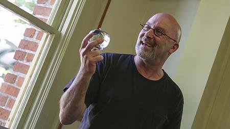 Professor holding glass ball