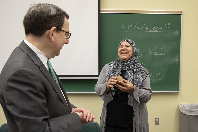 Hanan Elsherif receiving a Distinguished Teaching Award from President Schill